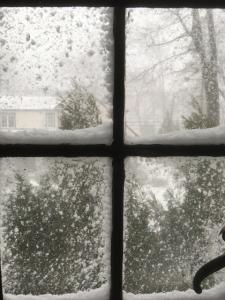 Snowstorm seen through a window