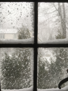 Snowstorm seen through a window