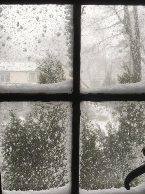 Snowstorm through a window