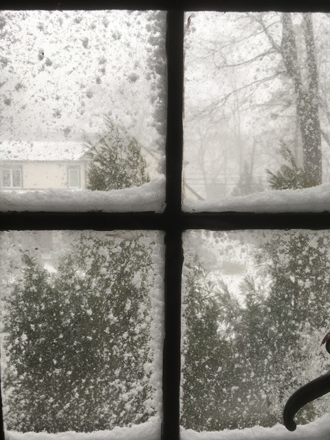 Snowstorm through a window