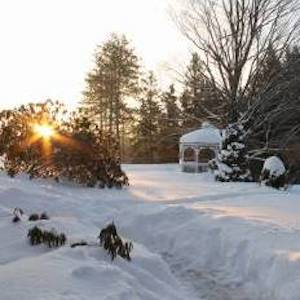 Morning light on snow-covered gazebo