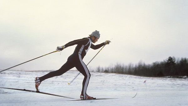 Photo of Bill Koch skiing cross-country classic technique in 1979s