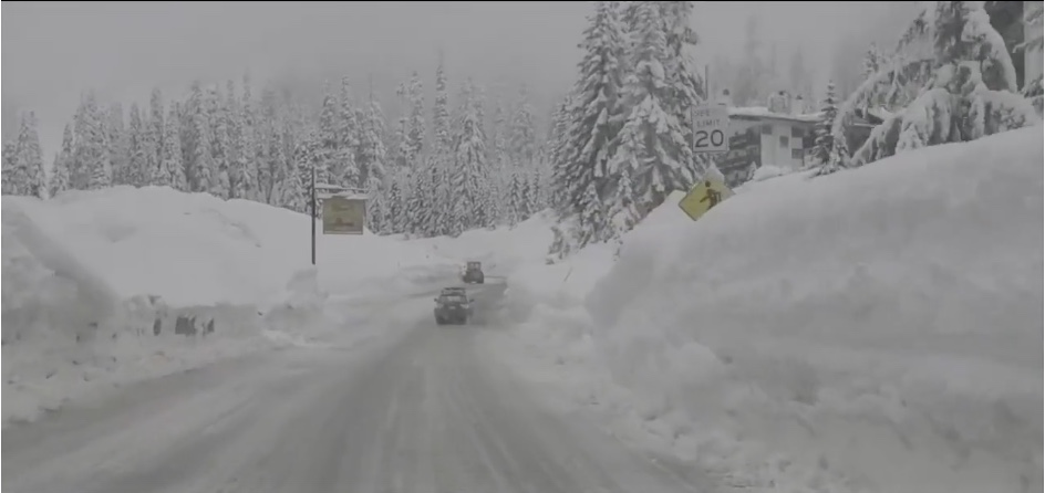 Snoqualmie pass highway surrounded by six-foot snowbanks, Jan. 2021